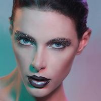 Beauty makeup on model with metallic lips