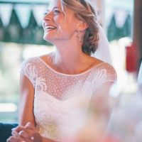 Happy bride with makeup by Maya Lewis
