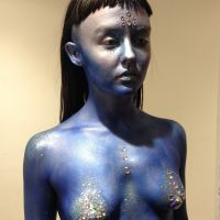 Model painted in blue with bodypaint and hair by Maya Lewis