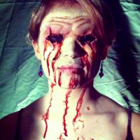Model with Halloween prosthetics & makeup, eyes missing