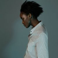 Model with shirt and hair up for fashion photoshoot