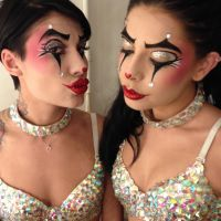 Cara Delahoyde and friend in showgirl clown makeup by Maya Lewis
