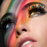 Rainbow makeup and glossy lips on beautiful model