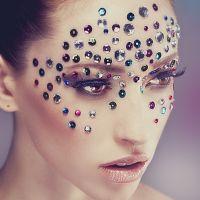 Model with beauty makeup wearing gemstones