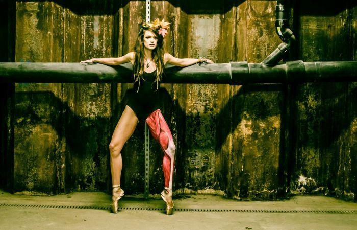 Anatomical bodypaint on a ballet dancer showing leg muscles