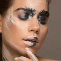 fashionable facepaint on model Emelie Stenman by Maya Lewis