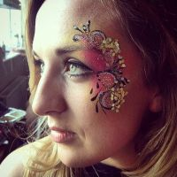Floral facepaint with glitter and gems