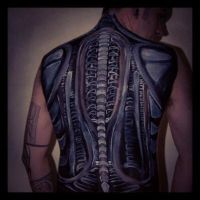 Giger-style biomech bodypaint on a model's back