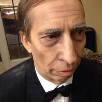 Male actor made up for Halloween as butler