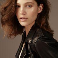 Fashion model headshot wearing leather jacket