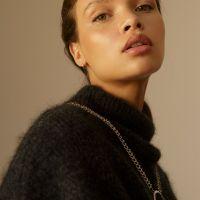 Model with sleek, dewy makeup