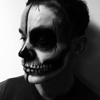 Man painted with skull makeup facepaint for Halloween