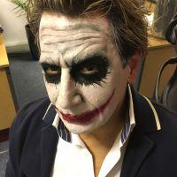 A man with The Joker facepaint